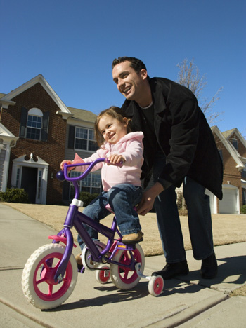 teaching-child-to-ride-bicycle